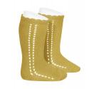 Calcetines altos perlé calado lateral MOSTAZA
